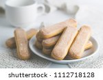 biscuit savoiardi with a cup of ... | Shutterstock . vector #1112718128