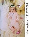 Small photo of Portrait beautiful baby girl posed in a bowl on her back and smiling. Adorable newborn