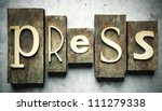 Press concept, retro vintage letterpress type on grunge background - stock photo