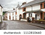 winding street  with old houses ... | Shutterstock . vector #1112810660