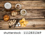 beer in the glass and covers on ... | Shutterstock . vector #1112831369