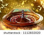 Collage of casino images with a close-up vibrant image of multicolored casino roulette table with poker chips - stock photo