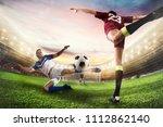 soccer striker hits the ball... | Shutterstock . vector #1112862140