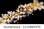 close up of white pearl with... | Shutterstock . vector #1112869370