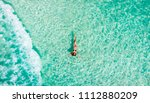young woman floating in the... | Shutterstock . vector #1112880209
