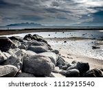 Giant Rocks On A Beach During...