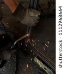 Small photo of Worker welding the steel part by manual, welding splatter repairman, lifestyles, light weld