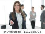 friendly business woman holding ...   Shutterstock . vector #1112985776
