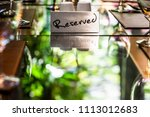 reserved metal plate on the... | Shutterstock . vector #1113012683