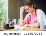 doctor with headache stressed ...   Shutterstock . vector #1113073763