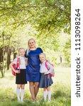 happy mom hugging two daughters ...   Shutterstock . vector #1113098264