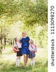 happy girls in school uniform...   Shutterstock . vector #1113098270