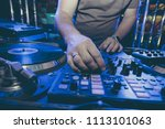dj mixes at the music festival  ...   Shutterstock . vector #1113101063
