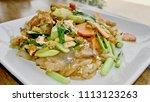 stir fried broad rice noodles... | Shutterstock . vector #1113123263
