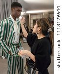 Small photo of NEW YORK, NY - Feb 05, 2018: A model prepares backstage before the Bode Presentation during New York Fashion Week Men's F/W 2018