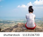 Small photo of Women with white shirts. Sitting in a lonely mood alone. And look out to nature in the foreground. She is thinking, despair Or discouraged. With natural atmosphere around. At the top of mountains.
