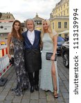 Small photo of Dresden Sachsen Germany june 8 2018: Rebecca Kunikowski Hermann Buehlbecker CEO Lambertz and Model Anna Hiltrop during the European Culture Awards TAURUS