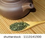 clay teapot and wooden spoon... | Shutterstock . vector #1113141500