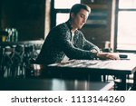 a young man spends time in a... | Shutterstock . vector #1113144260