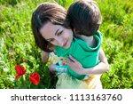 mother hugs the boy. a woman is ...   Shutterstock . vector #1113163760