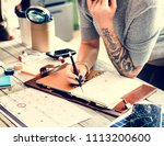 tattooed woman planning | Shutterstock . vector #1113200600