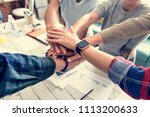 co workers stacking hands | Shutterstock . vector #1113200633
