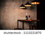 Stock photo interior design of restaurant or cafe side photo of wooden table with bottle champagne or wine and 1113221870