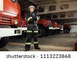 fireman  firefighter  in action ... | Shutterstock . vector #1113223868