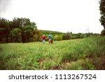 a woman with children runs...   Shutterstock . vector #1113267524