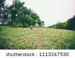 a woman with children runs...   Shutterstock . vector #1113267530