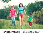 children walk with their mother ...   Shutterstock . vector #1113267560
