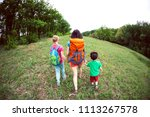 a woman with children goes...   Shutterstock . vector #1113267578