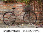 Small photo of YARRA VALLEY, VICTORIA, AUSTRALIA - 04 MAY 2016: A decorative rusty old bicycle leans against a brick wall and an open iron gate at Stones Winery just outside Yarra Glen in Melbourne's Yarra Valley.