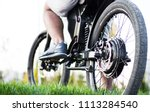 man biker sitting on electric... | Shutterstock . vector #1113284540