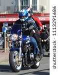 Small photo of Hastings,East Sussex/UK 07/05/18 Bike 1066 the annual May Day bike run to Hastings. A blue Suzuki motorbike with pillion passenger arrives on Hastings seafront to join thousands of other motorcycles