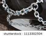 large tire with snow chains    Shutterstock . vector #1113302504