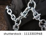car tire with snow chains    Shutterstock . vector #1113303968