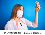 girl in a medical suit holds a ... | Shutterstock . vector #1113310010