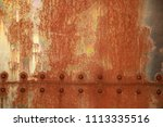 rusty background with rivets | Shutterstock . vector #1113335516