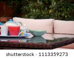 A Tray With A Dotty Teapot And...