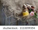 wild rose hip honey in a glass... | Shutterstock . vector #1113359354