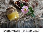wild rose hip honey in a glass... | Shutterstock . vector #1113359360