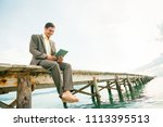 businessman by the sea | Shutterstock . vector #1113395513