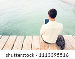 businessman by the sea | Shutterstock . vector #1113395516