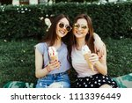 portrait of two young women... | Shutterstock . vector #1113396449