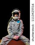 female astronaut in spacesuit... | Shutterstock . vector #1113425516