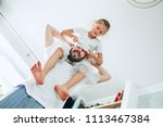 the happy father and his six...   Shutterstock . vector #1113467384