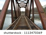 Train Tracks Over A Bridge In...