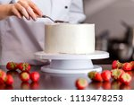 pastry chef  makes a wedding... | Shutterstock . vector #1113478253