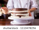 pastry chef  makes a wedding... | Shutterstock . vector #1113478256